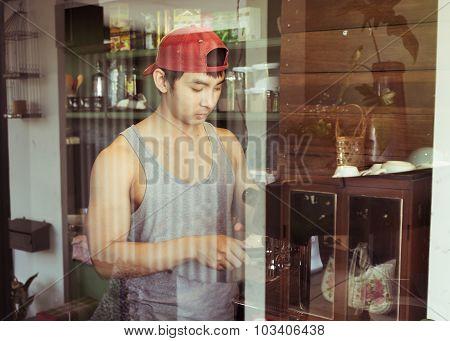 Handsome Man Barista Working Make A Coffee Drink At Cafe, Image Used Vintage Filter