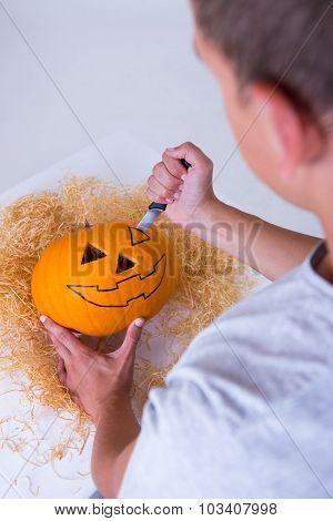 Man Carving Pumpkin Jack-o-lantern For Halloween