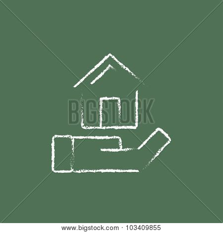 House insurance hand drawn in chalk on a blackboard vector white icon isolated on a green background.