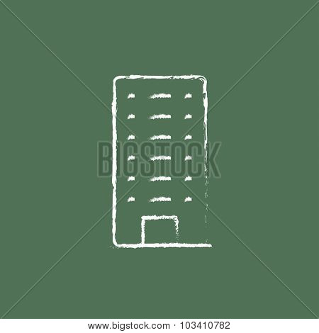 Residential building hand drawn in chalk on a blackboard vector white icon isolated on a green background.