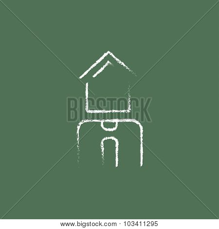 Real estate agent hand drawn in chalk on a blackboard vector white icon isolated on a green background.