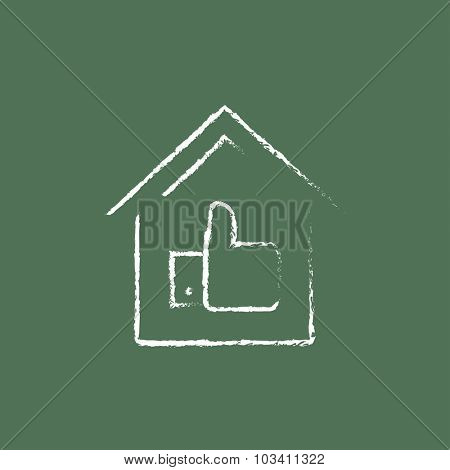 Thumb up in house hand drawn in chalk on a blackboard vector white icon isolated on a green background.
