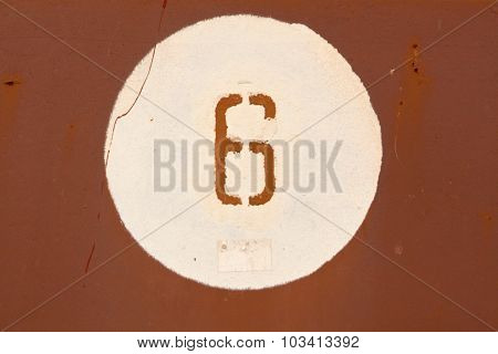 Number Six On Red Metal Wall.