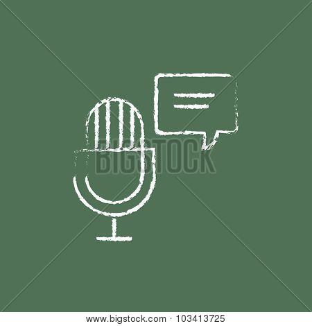 Microphone with speech bubble hand drawn in chalk on a blackboard vector white icon isolated on a green background.