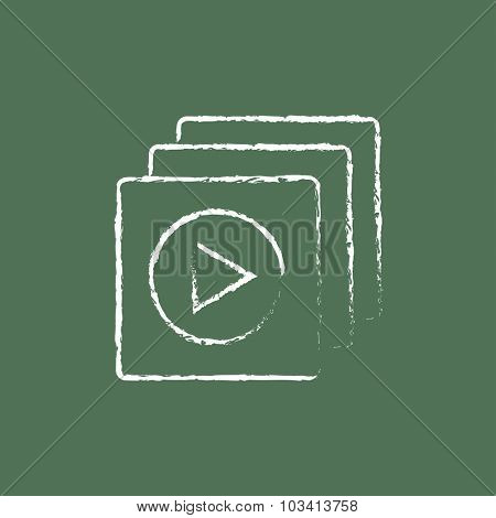 Media player hand drawn in chalk on a blackboard vector white icon isolated on a green background.
