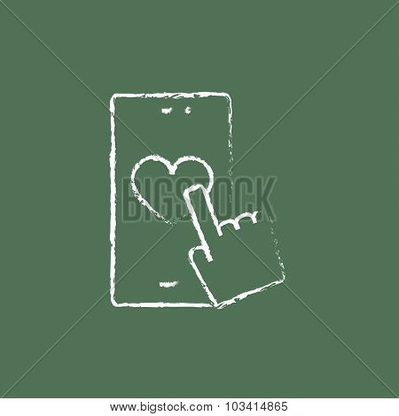 Smartphone with heart sign hand drawn in chalk on a blackboard vector white icon isolated on a green background.