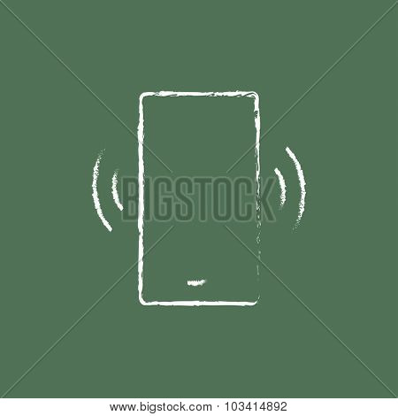 Vibrating phone hand drawn in chalk on a blackboard vector white icon isolated on a green background.