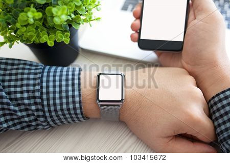 Man Hands Watch And Phone With Isolated Screen