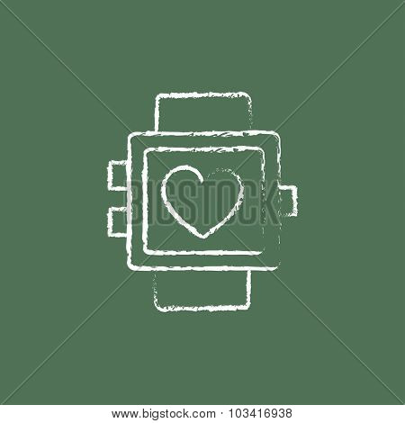 Smartwatch with heart sign hand drawn in chalk on a blackboard vector white icon isolated on a green background.