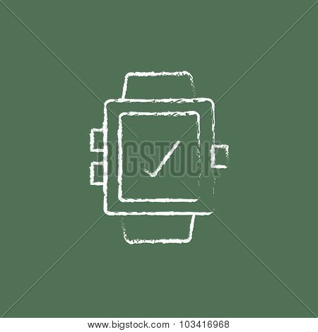 Smartwatch with check sign hand drawn in chalk on a blackboard vector white icon isolated on a green background.