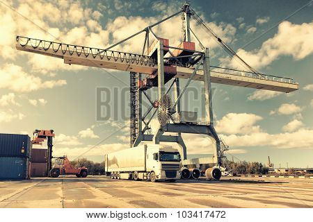 Truck Container Truck And Crane In The Port