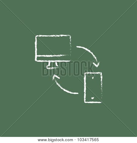 Synchronization computer with mobile device hand drawn in chalk on a blackboard vector white icon isolated on a green background.