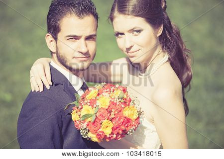 Happy Just Married Bride And Groom On Green Grass Background