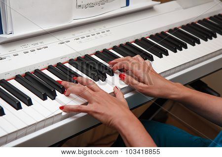 Hands Of A Young Woman Playing The Piano