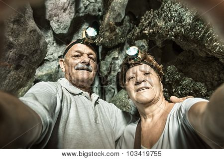 Senior Happy Couple Taking A Selfie At The Entrance Of Tham Phu Kham Vang Vieng - Adventure Travel