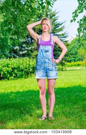 Portrait Slender Blonde Of 20 Years In Park