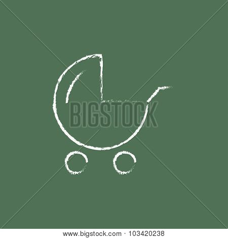 Baby stroller hand drawn in chalk on a blackboard vector white icon isolated on a green background.