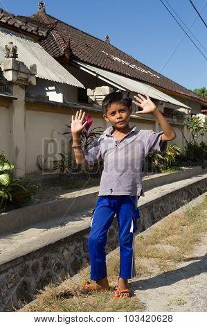 Indonesian Boy On Toyapakeh Street