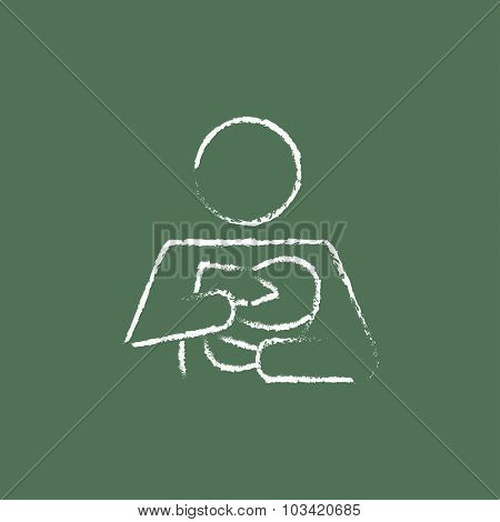 Woman nursing the baby hand drawn in chalk on a blackboard vector white icon isolated on a green background.