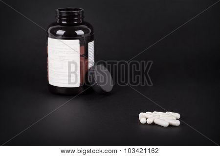 White Pills On A Dark Background