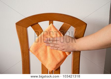 Hand Wiping A Chair