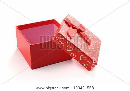 Open Red Gift Box With Bow And Painted Hearts Isolated