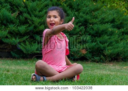 Excited Child Screaming And Showing Thumb Up, Gypsy Girl