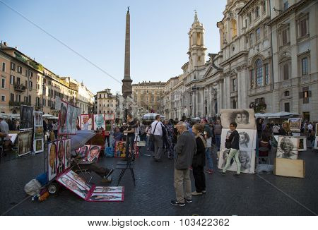 ROMA, ITALY-SEPT 24, 2015:  Old couple looking at the caricature and paintings at Navonna place the biggest place in Roma which is a nice example of Baroque Roman architecture  in Roma, Italy