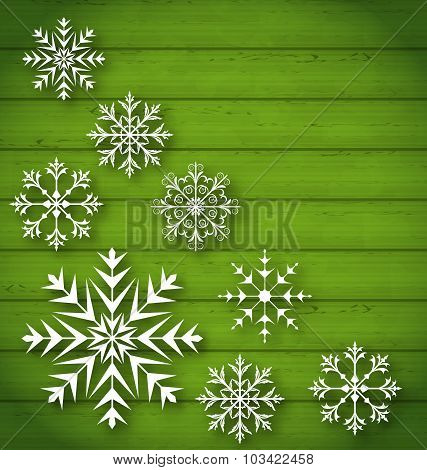 Set geometric snowflakes on wooden background