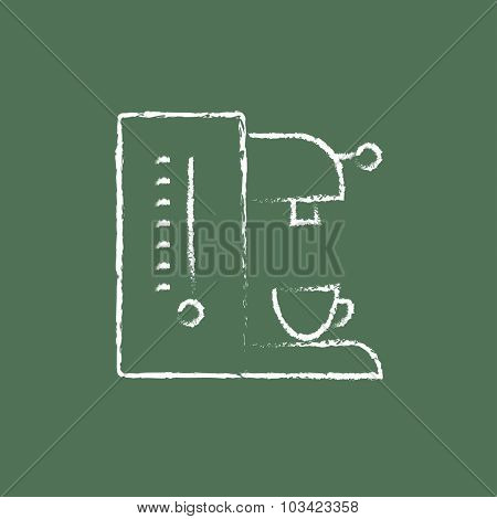 Coffee maker hand drawn in chalk on a blackboard vector white icon isolated on a green background.