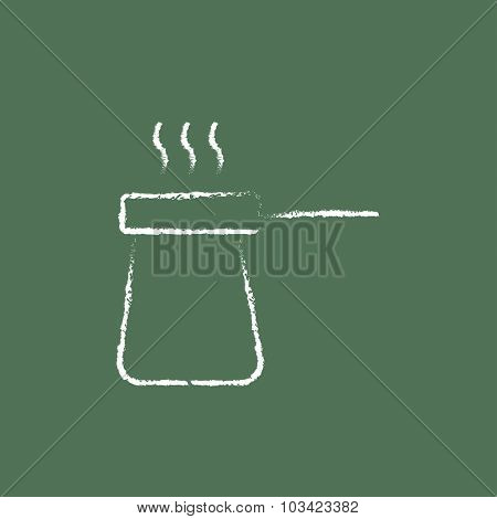 Coffee turk hand drawn in chalk on a blackboard vector white icon isolated on a green background.