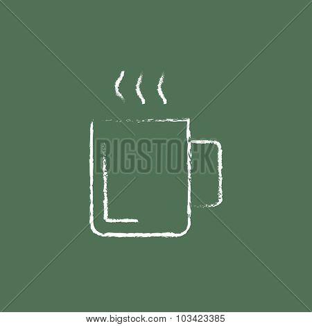 Mug of hot drink hand drawn in chalk on a blackboard vector white icon isolated on a green background.