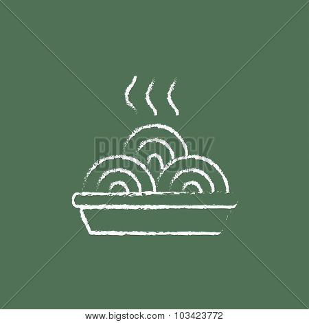Hot meal in plate hand drawn in chalk on a blackboard vector white icon isolated on a green background.