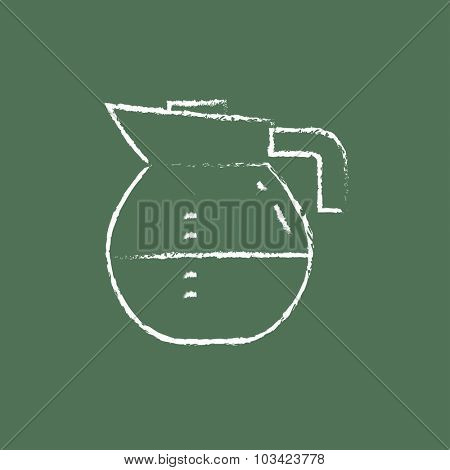 Carafe hand drawn in chalk on a blackboard vector white icon isolated on a green background.