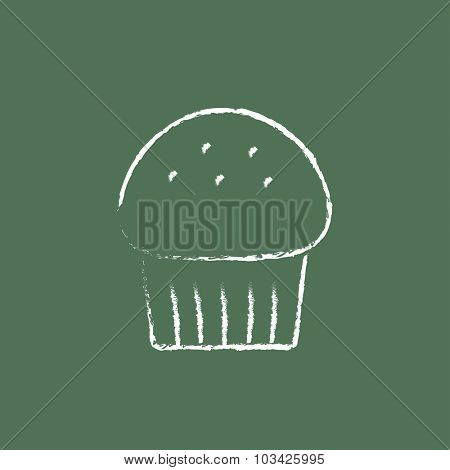 Cupcake hand drawn in chalk on a blackboard vector white icon isolated on a green background.