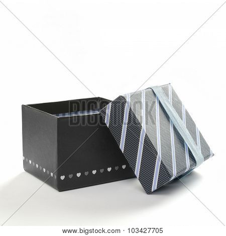 Open Black Gift Box With Ribbon And Blue Lines Front