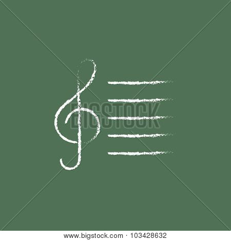 Treble clef hand drawn in chalk on a blackboard vector white icon isolated on a green background.