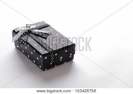 Small Black Gift Box With Ribbon And Circles