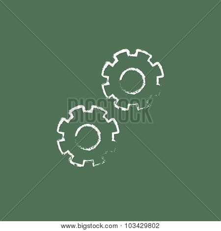 Gears hand drawn in chalk on a blackboard vector white icon isolated on a green background.