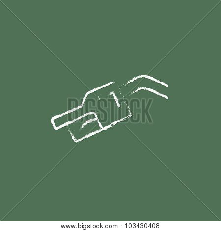 Gasoline pump nozzle hand drawn in chalk on a blackboard vector white icon isolated on a green background.