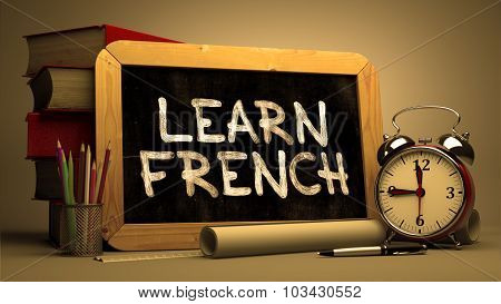 Learn French - Motivational Quote on Chalkboard.