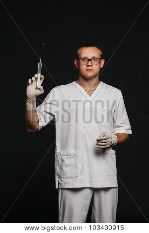 doctor in a white lab coat and glasses with syringe