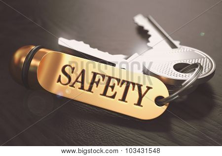 Keys to Safety. Concept on Golden Keychain.