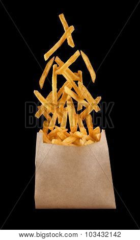 Fastfood. Flying Fried Potatoes On Black Background.