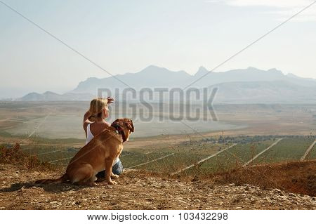 Beautiful Girl With Dog On The Mountain Top