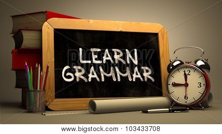 Handwritten Learn Grammar on a Chalkboard.