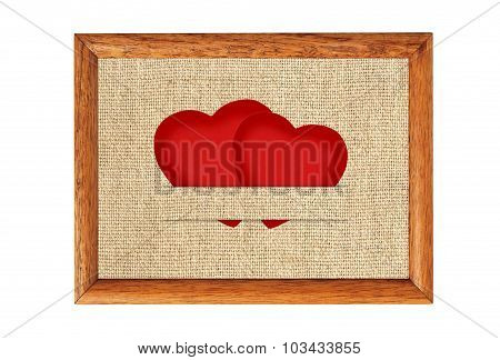 Vintage Valentine Card In The Form Of Red Paper Hearts On Fabric Burlap Background In Wooden Frame