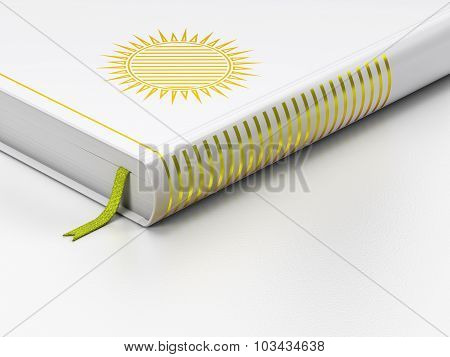 Travel concept: closed book, Sun on white background