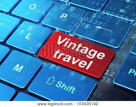 Tourism concept: Vintage Travel on computer keyboard background