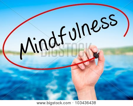 Man Hand writing Mindfulness with black marker on visual screen.